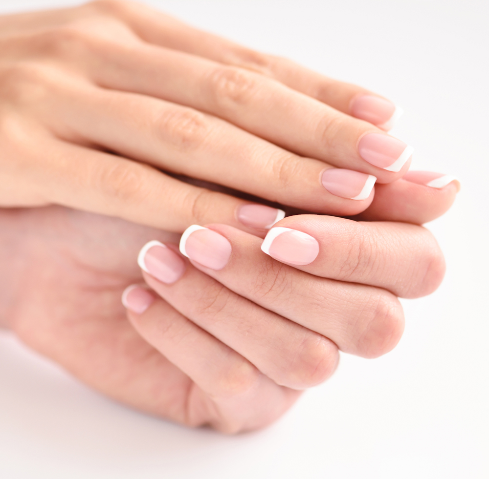 beautiful-woman-hands-with-french-manicure-PC9GNMH.jpg